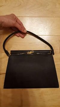 Vintage era black satin purse with metal top trim