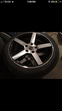 4 Strada black & silver rims,  215 / 45 zr 17 tires withchrome nuts