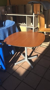 White and brown pedestal table