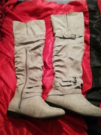 pair of white leather half-zip knee-high buckled boots Prince George, V2L 2R4
