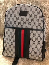 gray and black Gucci backpack كولومبوس, 43221