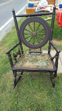 Spinning wheel rocking chair