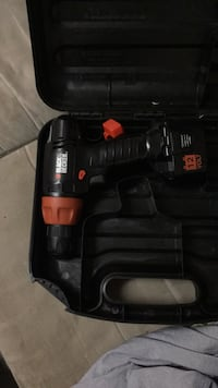 black and red Milwaukee cordless power drill with case 3724 km