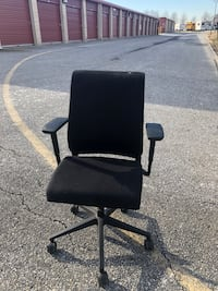 black leather padded rolling chair
