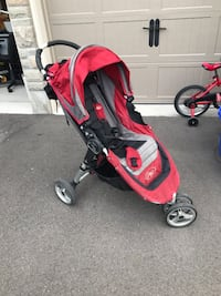 baby's red and black jogging stroller King, L7B 0C6