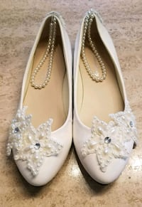 pair of white and pearl weddimg shoes flats