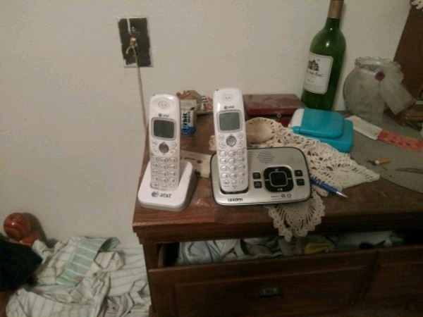 white and gray Vtech wireless home phone