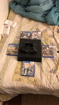 black Sony PS4 console with controller and game cases Miami, 33138