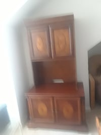 Brown wood cabinet with design motif 50 km