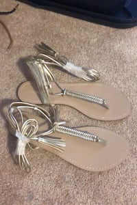 Gold gladiator sandals size 8 never been worn