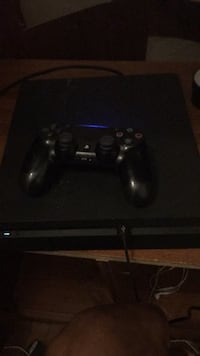 black Sony PS4 console with controller Muskegon, 49442