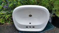 white ceramic sink with stainless steel faucet Toronto