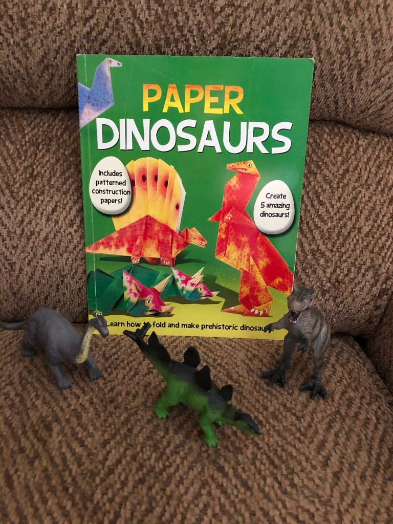 Photo New Learn how to make paper dinosaur workbook. Three dinosaurs figures