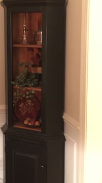 Two tone corner cabinet hutch .  Items inside hatch included if like .   Sparta, 07871