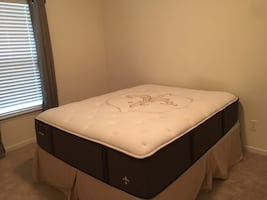 Almost new stearns and fosters queen mattress and box spring
