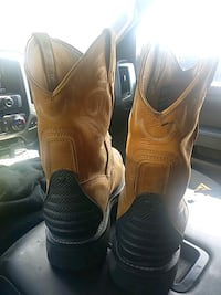 pair of brown leather cowboy boots Houston, 77032