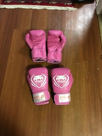 Two pairs of venum boxing gloves