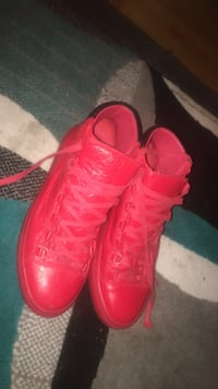 pair of red high-top sneakers Calgary, T2A 2Y7