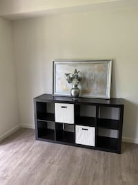 Storage/TV Stand (Barely Used). Includes two foldable boxes. Original MSRP $150