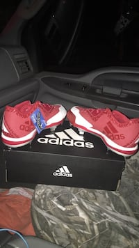 pair of red Adidas low-top sneakers with box