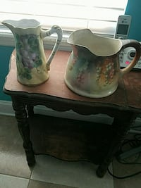 two white-and-green floral ceramic pitchers Orange Park, 32065