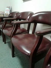 three brown leather padded armchairs