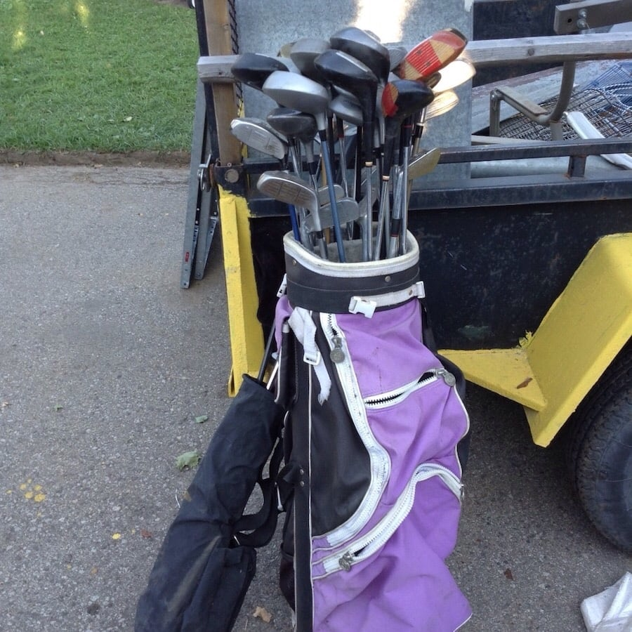 Golf clubs and purple golf bag