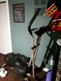 black and gray elliptical trainer 3153 km