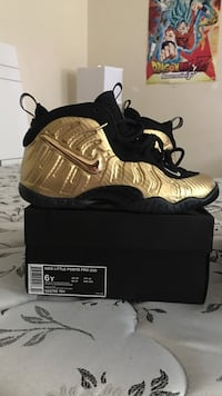 pair of gold-and-black Nike Air Foamposite shoes with box Jonesboro, 30236