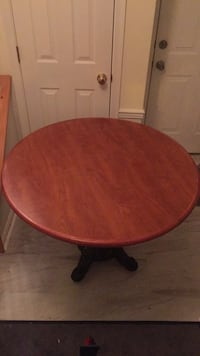 Round brown wooden table  Alexandria, 22312