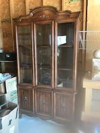 brown wooden framed glass display cabinet Edmonton, T6T 1G3