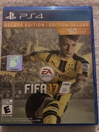 FIFA 17 Deluxe Edition PS4 game & case