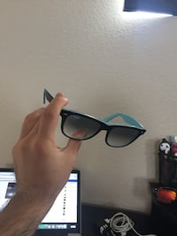 Black and teal Rayban Wayfarer sunglasses