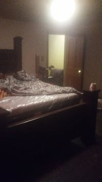 brown wooden bed frame and white mattress 27 km