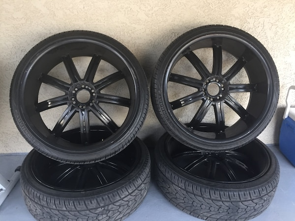 """Black 6 log nuts 26""""  wheels with semi new tires."""