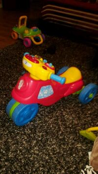 toddler's red and yellow ride-on trike Saint-Eustache, J7R 5G3