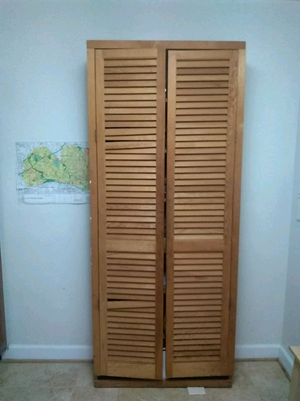 two brown wooden louver doors