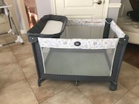 baby's gray and black travel cot Blainville, J7B 1Y1