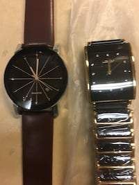 round black analog watch with black leather strap Tampa, 33605