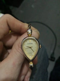 round gold-colored analog watch with link bracelet Vancouver, V6A 1G1