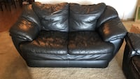 Black patent leather padded loveseat