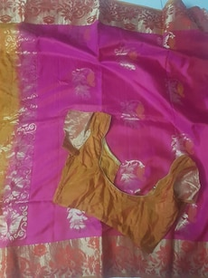 brown choli and pink floral dupatta