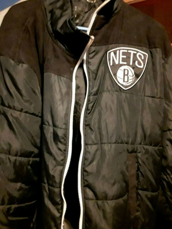 check out 68c25 0a56f black and white Oakland Raiders zip-up jacket