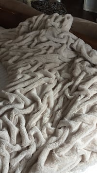 Off white chenille throw. Beautiful and soft. Looks great over couch of at the end of a bed