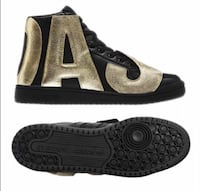 Pair of black-and-gold sneakers Capitol Heights, 20743