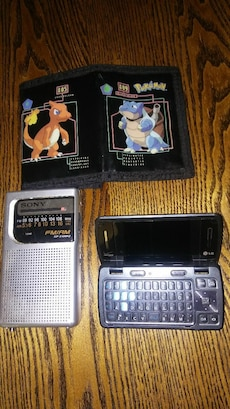 Cell phone. Pokemon wallet. Fm am. Radio.