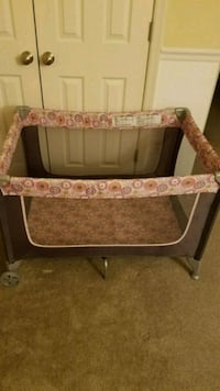 baby's black and pink Graco pack n play Hyattsville, 20782