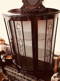 "Beautiful Antique curio with original curved glass w design. 3 shelves w fabric backing of the period   Good size for many options. 48""Hx 38""W Key in door Berwyn Heights, 20740"