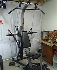 black and gray Bowflex lat pull down machine Denver, 80220