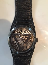 Black leather strap silver round faced guess skeleton watch Stillwater, 12866